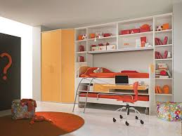 girls room playful bedroom furniture kids:  white wooden bunk bed with shelves and orange wooden wardrobe added by round red rug on