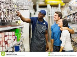 store assistant helping customers stock photo image  store assistant helping customers