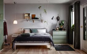 a small bedroom furnished with a bed for two in white metal with square patterned metal bedroom furniture at ikea