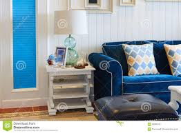 blue sofas living room: luxury living room with blue sofa glass table light at home royalty free stock photography