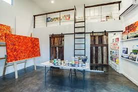 fabulous art studio with barn doors leading to the area that stores away the supplies artist office