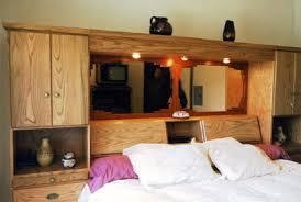 oak wall unit with paduak mirror frame bedroom wall furniture