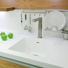 corian kitchen top: dupont corian solid surface countertops with seamless integrated sinks and a built in drain board kitchens pinterest google solid surface countertops