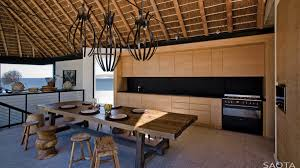 thatched roof beach house with outdoor entertaining spaces beach house lighting fixtures