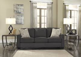 cream couch living room ideas:  brilliant living room with drum shape white table lamp and dark grey leather sofa also cream