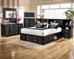 bedroom black furniture set simple floral motif bedcover beautiful flower design wood vanity wall theme featuring black bedroom furniture set