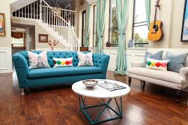 chic tufted couch in family room eclectic with beach condo ideas next to hanging guitar alongside blue sofa and blue couch chic family room decorating ideas