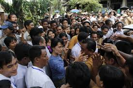 what is the truth behind the continuing persecution of the english aung san suu kyi greeting supporters