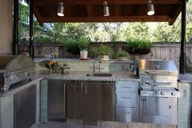 gallery outdoor kitchen lighting: outdoor kitchen with a roof texas