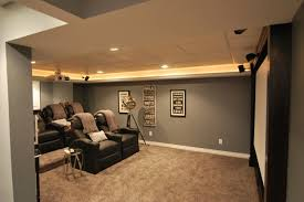 home cinema room with grey bedroomknockout carpet basement family