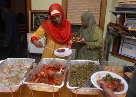 islam4 neon buffet bh muslim in america photo essays brad horrigan fawziyyah umrani and atiyah ibrahim break their fast at a family eid ul fitr dinner