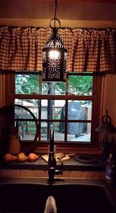 primitive lighting faucet curtains amish country kitchen light