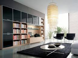 awesome living room design with wooden wall open storage bookshelves and white gloss round acrylic coffee table using metal base and double black chairs on awesome living room design