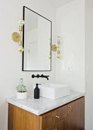 black white walnut bathroom with black faucet brass sconces brittanymakes brass bathroom lighting fixtures