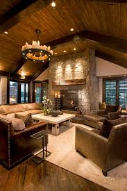 rustic style living room clever: living room that pottery barn candle chandelier is perfection my favorite design feature is the stone fireplace its so dramatic and rustic