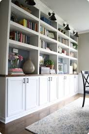 repurpose book shelves from storage unit to add to cupboard for builtins lookdiy built ins using cabinets as bases love this for a dining roomhomeschool build living room built ins