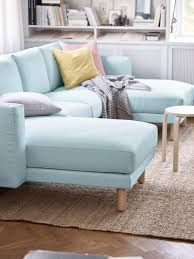 blue loveseat in white contemporary living room apartment scale furniture