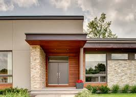 modern suburban design design ideas for a mid sized contemporary beige one story mixed siding flat add midcentury modern style