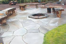 stone patio installation:  stone fire pit and benches