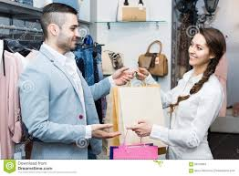 shop assistant helping customer at clothes shop stock images happy customer shop assistant stock photography
