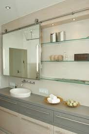 sliding bathroom mirror: didnt know you could do the barn door thing for your bathroom mirror