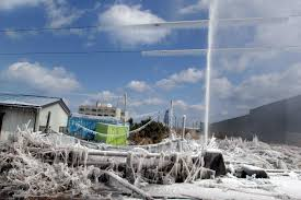 u s department of defense photo essay a water pipe spews water into the frosty morning air after being damaged by a tsunami