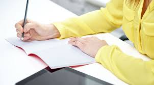 do you write well submit your essay and win   parkland     people technology and education concept   close up of female hands with tablet