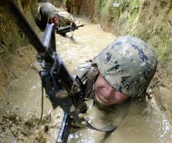 u s department of defense photo essay u s navy petty officer 3rd class jessie cani z crawls through a muddy trench on the jungle