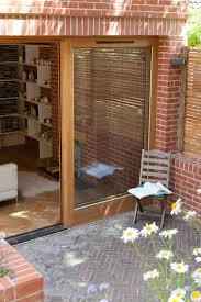 large sliding patio doors: large sliding oak door internal and external brickwork brick herringbone patio and internal oak