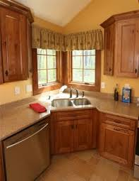 corner sinks design showcase: this is a beautiful showplace kitchen featuring our rustic alder savannah and tahoe door styles beautiful use of space this kitchens recessed corner sink