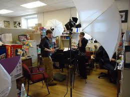 carolyn e case teamwork in dc carolyn case director of documentary somewhere called home works cinematographer john kiefer to setup an interview in a tight space in an office in