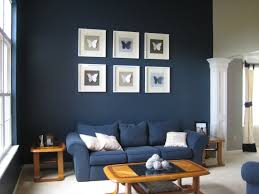 blue long sofa brown laminated wooden table wall excerpt and nicole miller home decor blue walls brown furniture