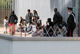 photo essay african migrants make desperate attempt to escape in pordenone a group of so and n refugees were awaiting processing they d just attempted the treacherous journey across the