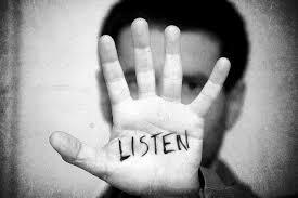 hand with listen written on it