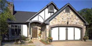 "European House Plans  Living the ""Old World"" Dream at HomeThis charming two story  three bedroom Tudor country home    its wood and stone facade  features an arched entryway   Plan"