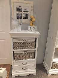 white storage unit wicker: white wicker storage unit with baskets