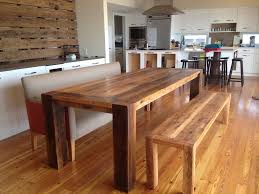 long wood dining table: adorable long wooden bench with solid wood dining table for excellent dining room plan combined with modern kitchen with sleek white cabinet