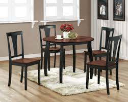 black kitchen dining sets:  small fur rug paired with black wooden kitchen chairs around dining table idea