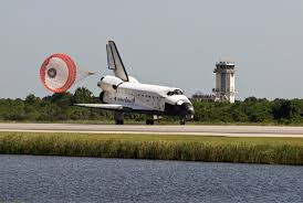<b>Space shuttle</b> Endeavour passes the <b>control</b> tower near Runway 15 ...