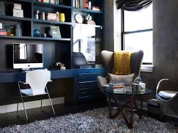 home office with dark blue bookcase wall unit and modern seating blue office walls