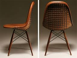 charles and ray eames herman miller dkw chair 1950s black steel wire frame with leather upholstery on walnut dowel legs charles and ray eames furniture