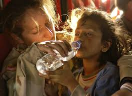 lowering the drinking age writework english u s army sergeant kornelia rachwal gives a young i girl a drink of water