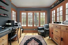 home office with wall of french style windows around room timber furniture and comfortable beautiful relaxing home office