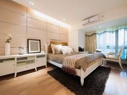 modern bedroom concepts: light modern bedroom with white bedroom furniture light wood flooring and small sitting area