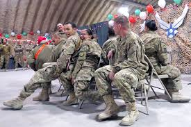 u s department of defense photo essay u s air force airmen play musical chairs during the christmas holiday party on kandahar