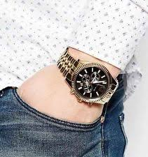 michael kors men s watch in gold michael kors lexington chronograph black dial gold tone mens watch mk8286
