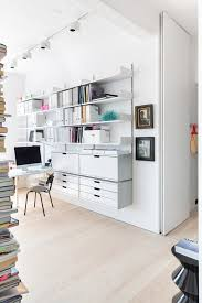 london loft danish home studio photo in london with white walls light hardwood floors and a algot white wall mounted storage solution