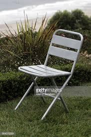 accordion folding chair from crate barrel lightweight aluminum construction matte silver finish aluminum crate barrel