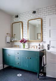 bathroom refresh: bathroom refresh dark teal wash finish on bathroom vanity with brass hardware framed mirrors