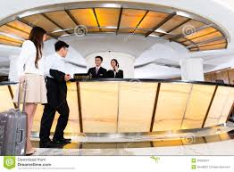 hotel receptionist working at front office stock photo image asian chinese couple arriving at hotel front desk stock images